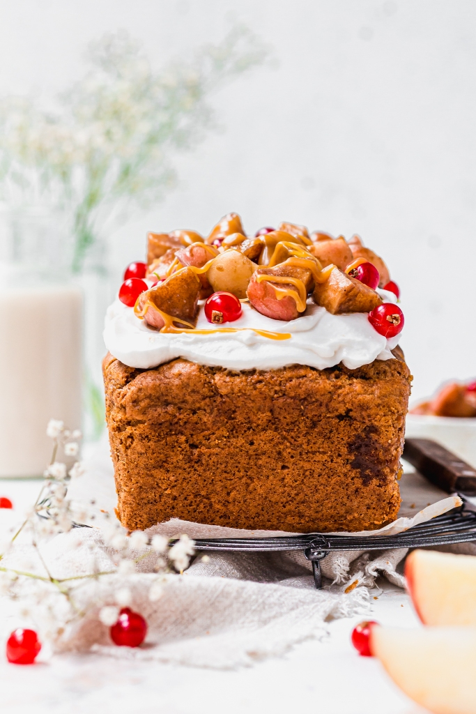 A Caramel Apple Loaf Cake with apples and redcurrants